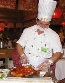 Chinese Chef Slicing Peking Duck